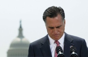 U.S. Republican Presidential candidate Mitt Romney pauses during his reaction to the Supreme Court's upholding key parts of President Barack Obama's signature healthcare overhaul law in Washington June 28, 2012. Romney said on Thursday that the American people must defeat President Barack Obama in order to overturn his landmark healthcare overhaul. REUTERS/Jonathan Ernst    (UNITED STATES - Tags: POLITICS HEALTH)
